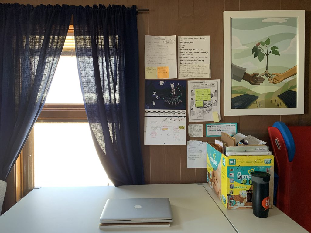 Graphic novelist and children's book illustrator Duachaka Her's white work desk at home.
